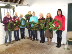 Workshop members display their finished wreaths after a creative morning at Chesworth Farm studio