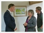 HDC chairman Christian Mitchell discusses the painting's detail with artist Heather Glenny, plus HDC senior countryside warden Jacob Everitt