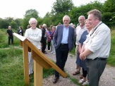 Guests study the Chesworth Farm wetland interpretation board, designed and illustrated by Helen Joubert (second from right)